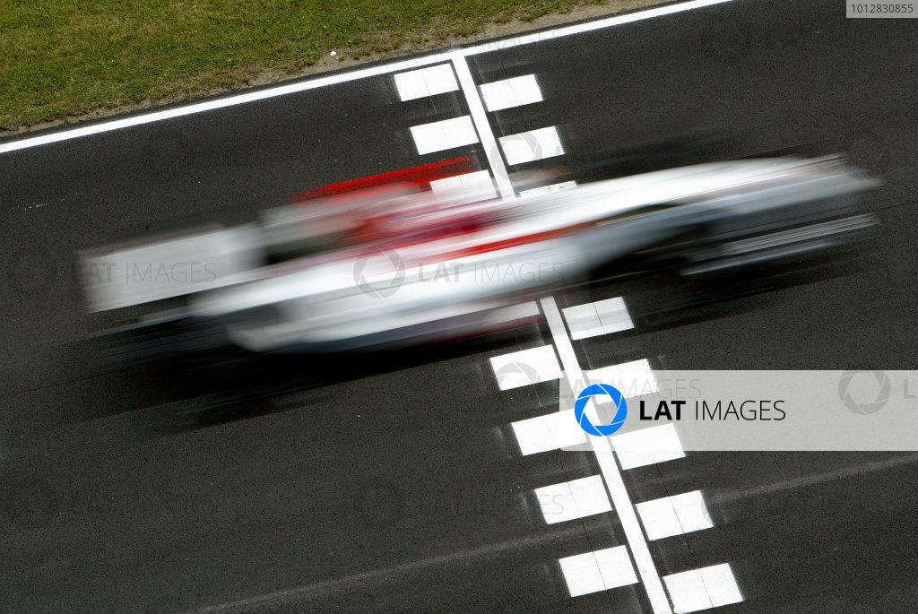 2004 Spanish Grand Prix - FridayCircuit de Catalunya, Barcelona, Spain. 7th - 9th May.Jenson Button, BAR Honda 006 speeds past the start line. Action.World Copyright: Peter Spinney/LAT Photographicref: Digital Image Only