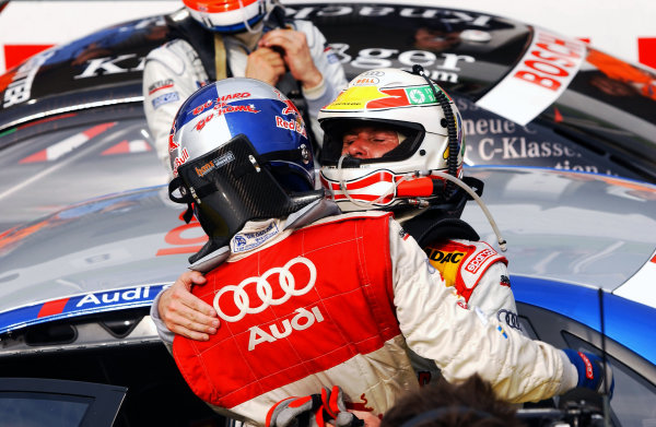 2004 DTM Championship Brno,Czech Republic. 18th - 19th September.Tom Kristensen (Abt Sportsline Audi A4) congratulates winning team mate Mattias Ekstrom (Abt Sportsline Audi A4) after the race.World Copyright: Andre Irlmeier/LAT Photographic ref: Digital Image Only