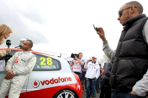Nicolas Hamilton (GBR), Total Control Racing, is interviewed whilst brother Lewis Hamilton (GBR), McLaren, looks on.