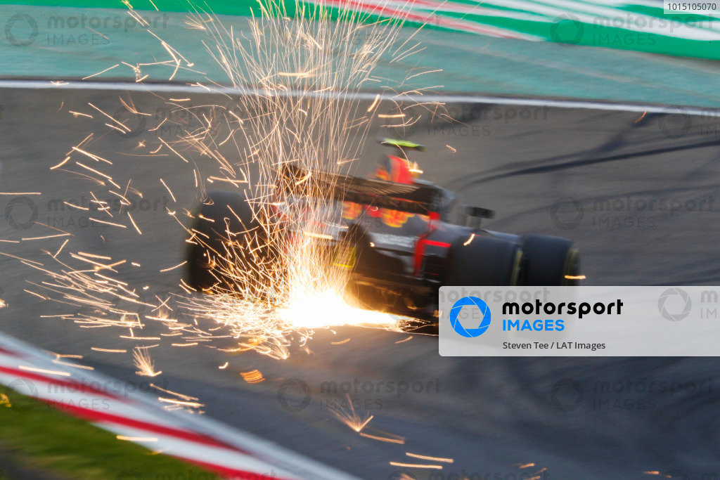 Sparks fly from the car of Max Verstappen, Red Bull Racing RB14 Tag Heuer.