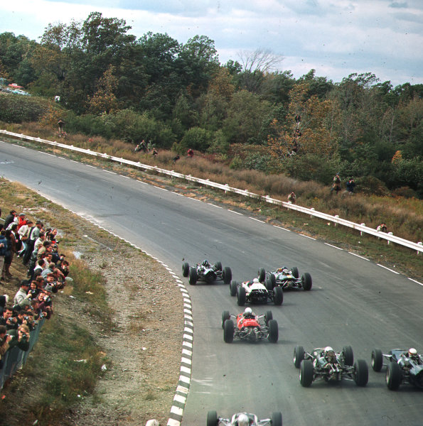 Watkins Glen, New York, USA.1-3 October 1965.Graham Hill (BRM P261) leads Jim Clark (Lotus 33 Climax) and the field at the start. Hill finished in 1st position.Ref-3/1850.World Copyright - LAT Photographic