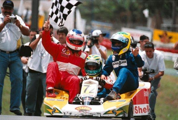 (L to R): Rubens Barrichello (BRA) won the event covering 746 laps with team mates Tony Kanaan (BRA) and Felipe Massa (BRA).Granja Viana 500 Kart Race, Granja Viana Circuit, Sao Paulo, Brazil, 10 November 2002.