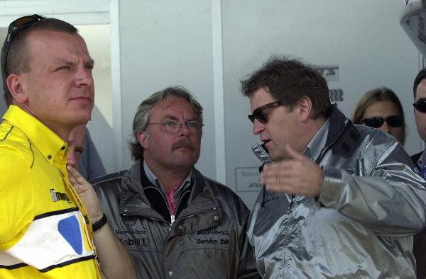 Mercedes Sporting Director Norbert Haug (GER), right, chats to former Formula 1 World Champion Keke Rosberg (FIN).Formula BMW ADAC Championship, Rd5, Norisring, Germany. 30 June 2002.DIGITAL IMAGE