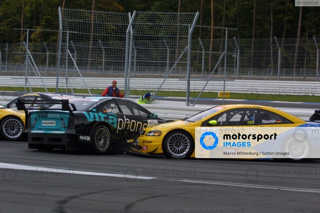 DTM Championship 2002, Round 10 - Hockenheimring, Germany, 6 October 2002 - Manuel Reuter (Opel Team Phoenix) was forced to retire early when he was unable to avoid a collision with fellow Opel driver Michael Bartels (Opel Team Holzer).