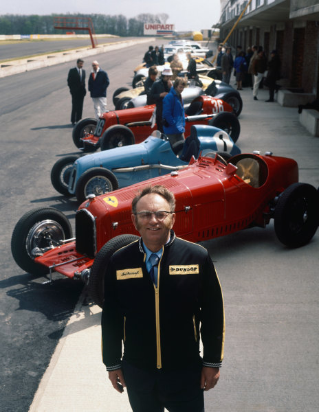Tom Wheatcroft with a collection of cars from the Donington Museum, portrait.