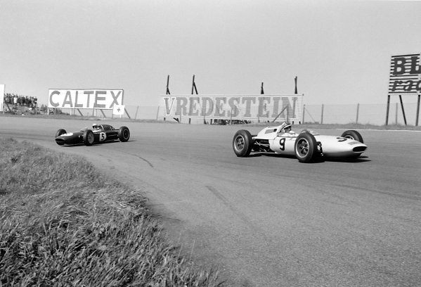 1962 Dutch Grand Prix Zandvoort, Holland. 18-20 May 1962 Innes Ireland (Lotus 24-Climax) passes the spinning Trevor Taylor (Lotus 24-Climax). Taylor finished in 2nd position World Copyright: LAT PhotographicRef: Autosport b&w print