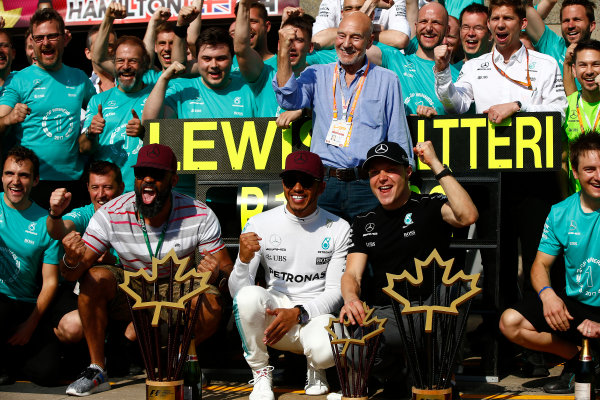 Circuit Gilles Villeneuve, Montreal, Canada. Sunday 11 June 2017. Lewis Hamilton, Mercedes AMG, 1st Position, and Valtteri Bottas, Mercedes AMG, 2nd Position, celebrate with their team. World Copyright: Andrew Hone/LAT Images ref: Digital Image _ONY7254
