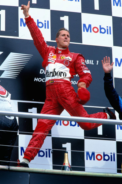 2004 German Grand Prix Hockenheim, Germany. 23rd - 25th July. Michael Schumacher, Ferrari F2004 leaps with joy after winning his home grand prix, also equaling his record of a eleven victories in a season. World Copyright:Lorenzo Bellanca/LAT Photographic  Ref:35mm Image:A21