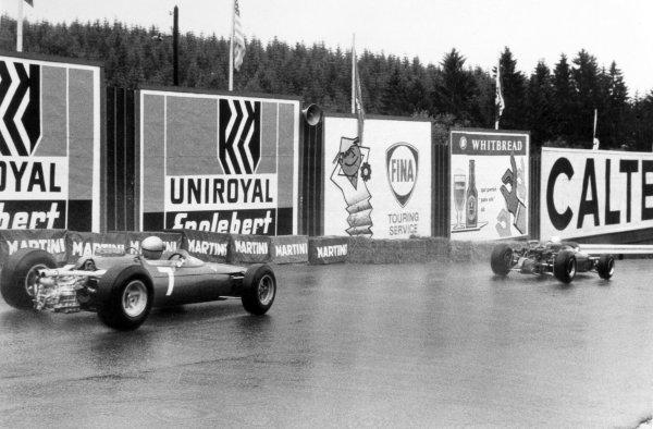 1966 Belgian Grand Prix.Spa-Francorchamps, Belgium. 12 June 1966.Jochen Rindt, Cooper T81-Maserati, 2nd position, leads John Surtees, Ferrari 312, 1st position, action.World Copyright: LAT PhotographicRef: Motor b&w print