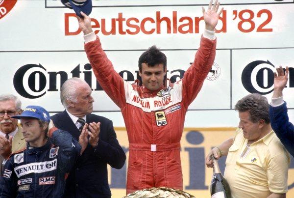 1982 German Grand Prix.Hockenheim, Germany. 8 August 1982.Rene Arnoux, Renault RE30B, 2nd position, and Patrick Tambay, Ferrari 126C2, 1st position, podium.World Copyright: LAT PhotographicRef: 35mm transparency 82GER