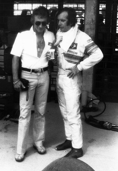 1979 Brazilian Grand Prix. Interlagos, Sao Paulo, Brazil. 2-4 February 1979. Ligier designer, Gerard Ducarouge chats to Emerson Fittipaldi (Copersucar F5A-Ford), 11th position, portrait.  World Copyright: LAT Photographic.  Ref:  B/W Print.