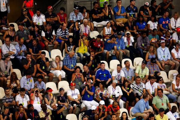 Yas Marina Circuit, Abu Dhabi, United Arab Emirates. Saturday 22 November 2014. Fans in a grandstand. World Copyright: Charles Coates/LAT Photographic. ref: Digital Image _J5R5146