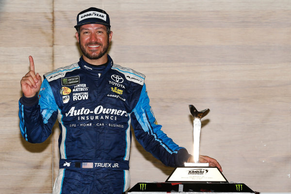 Monster Energy NASCAR Cup Series Go Bowling 400 Kansas Speedway, Kansas City, KS USA Sunday 14 May 2017 Martin Truex Jr, Furniture Row Racing, Auto-Owners Insurance Toyota Camry celebrates in victory lane  World Copyright: Russell LaBounty LAT Images ref: Digital Image 17KAN1rl_7953