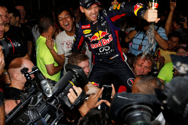 Buddh International Circuit, New Delhi, India. Sunday 27th October 2013. Sebastian Vettel, Red Bull Racing, 1st position, celebrates with fans after securing fourth drivers world title. World Copyright: Charles Coates/LAT Photographic. ref: Digital Image _N7T5895