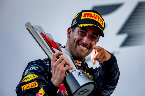 Sepang International Circuit, Sepang, Malaysia. Sunday 2 October 2016. Daniel Ricciardo, Red Bull Racing, 1st Position, celebrates victory on the podium with his trophy. World Copyright: Zak Mauger/LAT Photographic ref: Digital Image _X0W0341
