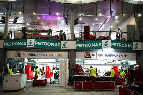 Sepang International Circuit, Sepang, Kuala Lumpur, Malaysia. Sunday 30 March 2014. The Ferrari garage in process of being dismantled. World Copyright: Charles Coates/LAT Photographic. ref: Digital Image _N7T8946