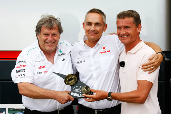 Valencia Street Circuit, Valencia, Spain22nd June 2012.Martin Whitmarsh, Team Principal, McLaren, receives a trophy from Norbert Haug, Vice President, Mercedes-Benz High Performance Engines, and David Coulthard, Commentator, BBC Sport F1, made using the wheel nut from the winning car of Lewis Hamilton last weekend and the wheel nut from Coulthards own race winning MP4-12 from the 1997 Australian Grand Prix.World Copyright:Charles Coates/LAT Photographicref: Digital Image _26Y9061