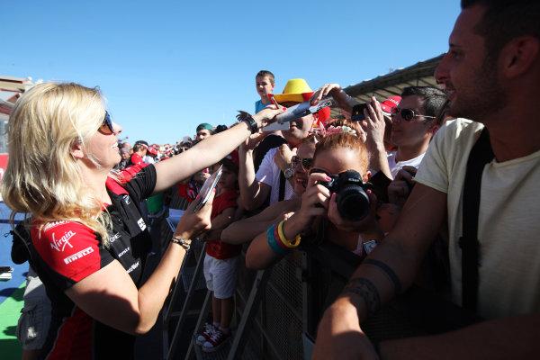 Valencia Street Circuit, Valencia, Spain 21st June 2012. Maria de Villota, Marussia F1, signs autographs for fans.  World Copyright:Glenn Dunbar/LAT Photographic ref: Digital Image IMG_3251