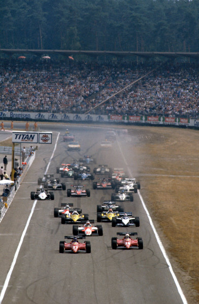 Hockenheim, Germany.5-7 August 1983.Patrick Tambay and Rene Arnoux (both Ferrari 126C3's) lead Andrea de Cesaris (Alfa Romeo 183T) and Nelson Piquet (Brabham BT52B BMW), Alain Prost and Eddie Cheever (both Renault RE40's) at the start. Ref-83 GER 06.World Copyright - LAT Photographic