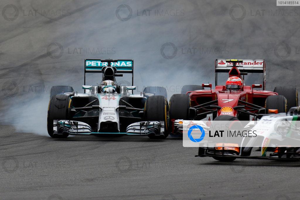 Hockenheimring, Hockenheim, Germany. Sunday 20 July 2014. Kimi Raikkonen, Ferrari F14T, and Lewis Hamilton, Mercedes F1 W05 Hybrid, clash as they fight for position. World Copyright: Alastair Staley/LAT Photographic. ref: Digital Image _79P0546