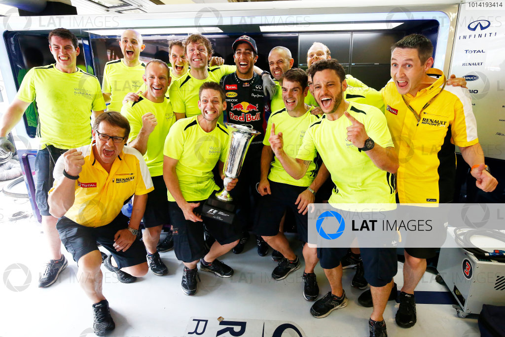 Hungaroring, Budapest, Hungary. Sunday 27 July 2014. Daniel Ricciardo, Red Bull Racing, 1st Position, celebrates victory with friends and colleagues. World Copyright: Andy Hone/LAT Photographic. ref: Digital Image _ONZ5026