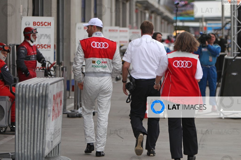 A disappointed championship leader Martin Tomczyk (GER), Audi Sport Team Phoenix, Schaeffler Audi A4 DTM (2008), walks away after his out in Q1.