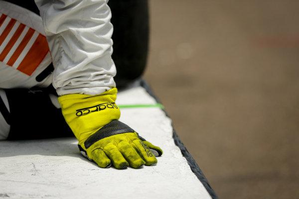 #5: Pato O'Ward, Arrow McLaren SP Chevrolet crew member, gloves