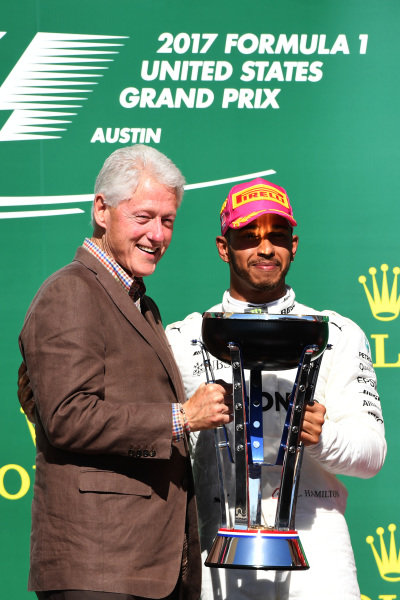 Race winner Lewis Hamilton (GBR) Mercedes AMG F1 celebrates on the podium with Bill Clinton (USA) and the trophy at Formula One World Championship, Rd17, United States Grand Prix, Race, Circuit of the Americas, Austin, Texas, USA, Sunday 22 October 2017.