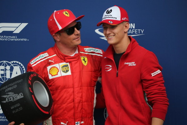 Mick Schumacher presents the Pirelli Pole Position Award to Kimi Raikkonen, Ferrari