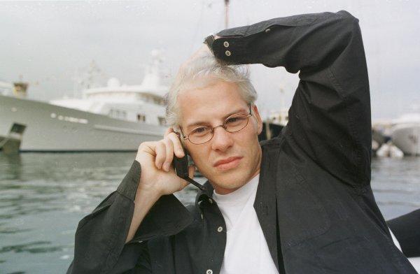 1998 Monaco Grand Prix.Monte Carlo, monaco.21-24 May 1998.Jacques Villeneuve (Williams Mecachrome) on his mobile phone on a boat in the harbour.World Copyright - Steve Etherington/LAT Photographic