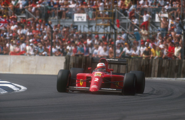 1990 British Grand Prix.Silverstone, England.13-15 July 1990.Nigel Mansell (Ferrari 641). He was leading the race when his gearbox began to malfunction, until finally on lap 55 it failed completely.Ref-90 GB 21.World Copyright - LAT Photographic
