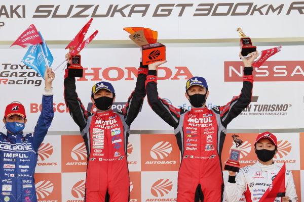 Tsugio Matsuda & Ronnie Quintarelli ( #23 MOTUL AUTECH NISMO Nissan GT-R ) winners in GT500, celebrate on the podium