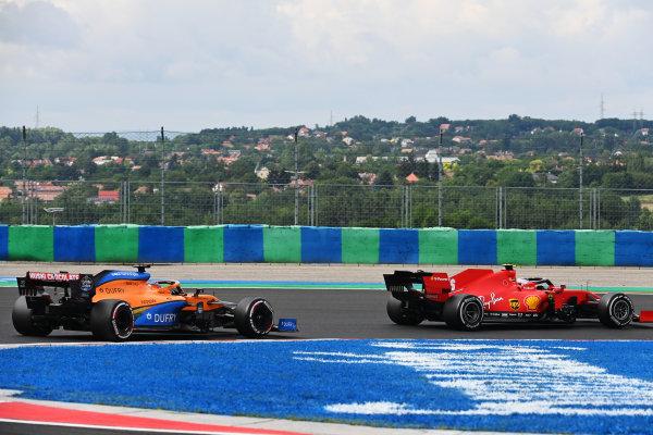 Charles Leclerc, Ferrari SF1000, leads Carlos Sainz, McLaren MCL35