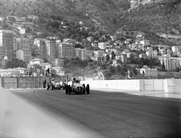 Louis Chiron, Maserati 4CLT-48, leads Juan Manuel Fangio, Alfa Romeo 158.