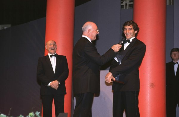 1991 Autosport Awards, Grosvenor House Hotel, Park Lane, London, Great Britain.Ayrton Senna receives the International Racing Driver of the Year from Murray Walker.Ref-S1A 02.World - LAT Photographic
