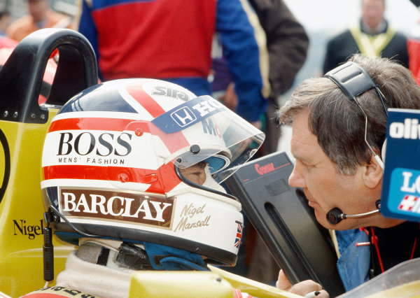 Spa-Francorchamps, Belgium.15th - 17th May 1987.Nigel Mansell (Williams FW11B Honda) retired, talks with team manager Patrick Head, portrait.World Copyright: Murenbeeld/ LAT Photographic.