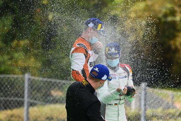 Larry ten Voorde (NED, Team GP Elite), 1st position, and Leon Kohler (DEU, Lechner Racing Middle East), 3rd position, celebrate on the podium with Champagne