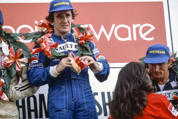 Alain Prost, 1st position, alongside René Arnoux, 3rd position, on the podium.
