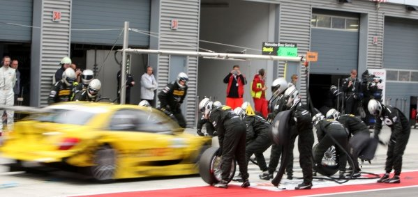 A pit stop for David Coulthard (GBR), Deutsche Post AMG Mercedes.DTM, Rd4, Eurospeedway Lausitz, Germany, 18-19 June 2011.