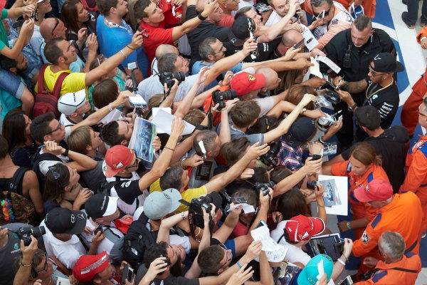 Autodromo Nazionale di Monza, Monza, Italy. Thursday 3 September 2015. Lewis Hamilton, Mercedes AMG, signs autographs for fans. World Copyright: Steve Etherington/LAT Photographic ref: Digital Image SNE23378