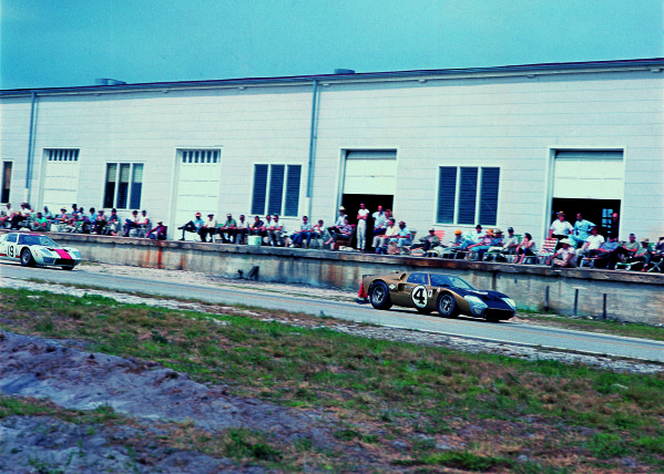 Sebring, Florida, USA.26 March 1966.A.J Foyt/Ronnie Bucknum, Ford GT40, 12th position, leads Skip Scott/Peter Revson, Ford GT40, 3rd position, action.Ref: 1992World Copyright: LAT Photographic