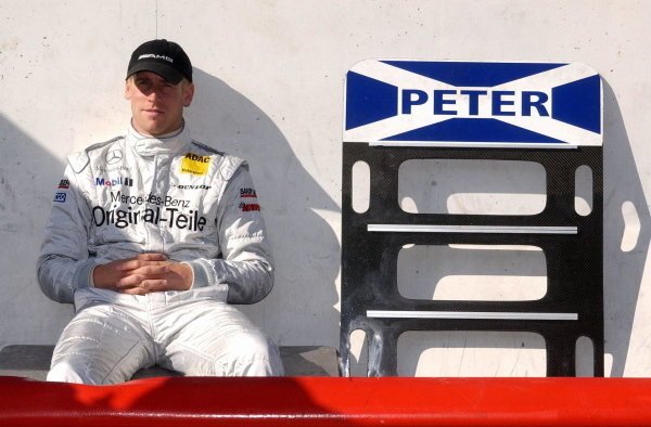 Peter Dumbreck (GBR), Original-Teile AMG-Mercedes awaits the start of the delayed qualifying session.DTM Championship, Rd9, Zandvoort, Holland. 29 September 2002.DIGITAL IMAGE