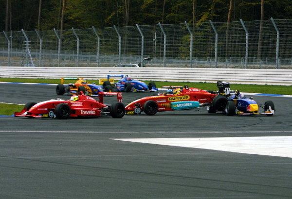 Norbert Siedler (AUT), Swiss Racing Team, and Bernard Auinger  (AUT), Opel Team BSR, collided in the new sharp hairpin.German Formula 3 Championship, Rd10, Hockenheim, Germany, 5-6 October 2002.DIGITAL IMAGE