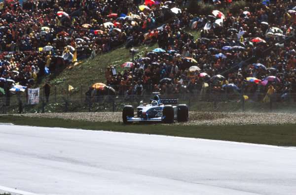1999 European Grand Prix.Nurburgring, Germany. 24-26 September 1999.Giancarlo Fisichella (Benetton B199 Playlife) spins off in the rain.World Copyright - LAT Photographic
