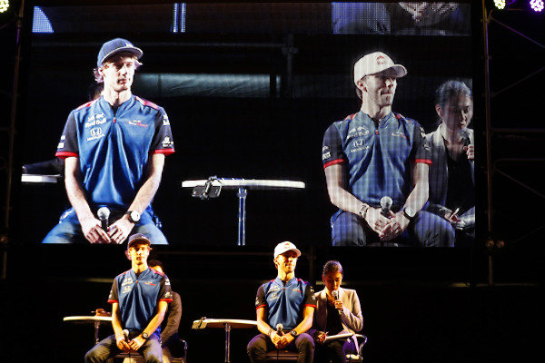 Brendon Hartley, Toro Rosso, and Pierre Gasly, Toro Rosso, attend a fan event.