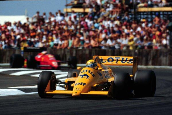 1987 British Grand Prix.Silverstone, England.10-12 July 1987.Ayrton Senna (Lotus 99T Honda) leads Michele Alboreto (Ferrari F187). Senna finished in 3rd position.World Copyright - LAT Photographic