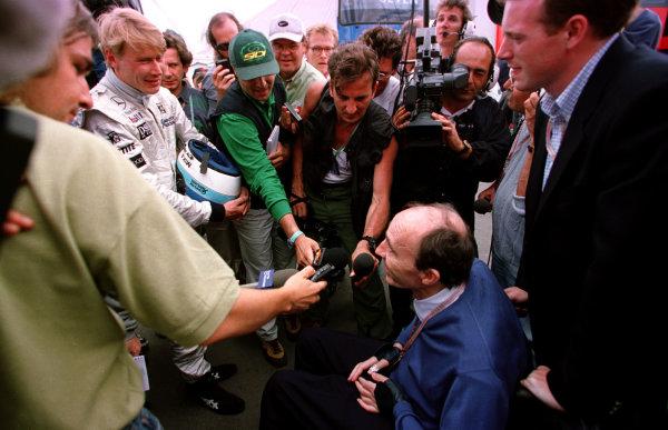 1997 British Grand Prix.Silverstone, England.11-13 July 1997.Frank Williams (Williams Renault team owner) talks to Mika Hakkinen (McLaren Mercedes-Benz).World Copyright - LAT PhotographicPhoto: LAT