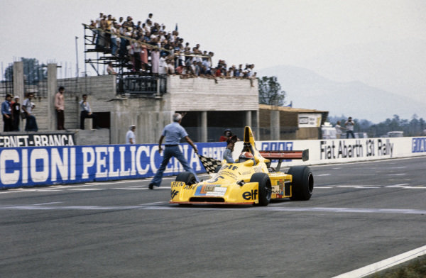 Jean-Pierre Jabouille, Elf 2J Renault, celebrates as he crosses the finish line to win.