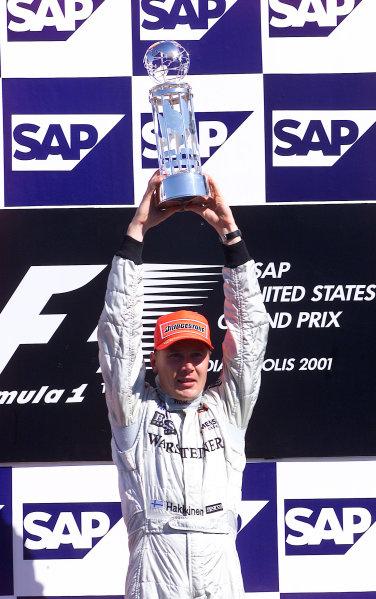 2001 American Grand Prix - RaceIndianapolis, United States. 30th September 2001.Race winner Mika Hakkinen, West McLaren Mercedes MP4/16, holds his trophy aloft in triumph.World Copyright: Steve Etherington/LAT Photographicref: 18mb Digital Image
