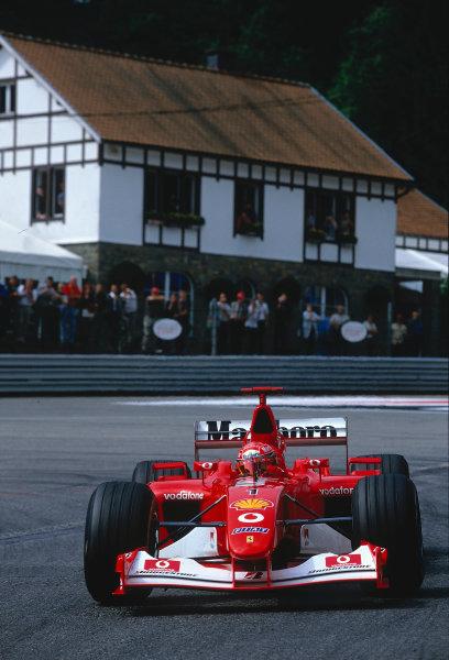 2002 Belgian Grand Prix.Spa-Francorchamps, Belgium. 30/8-1/9 2002.Michael Schumacher (Ferrari F2002) 1st position and a record 10th Grand Prix win in a single season, at La Source Hairpin. Ref-02 BEL 37.World Copyright - Rose/LAT Photographic